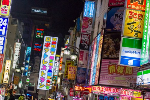 The colorful street lined with signs at night in Shinjuku, Tokyo, Japan
