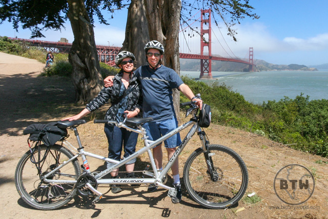 Aaron and Brianna by their tandem bike in front of San Francisco's Golden Gate Bridge | BIG tiny World Travel