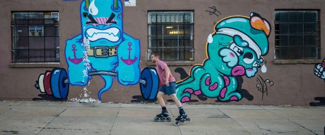Mike Lempko skating down the sidewalk