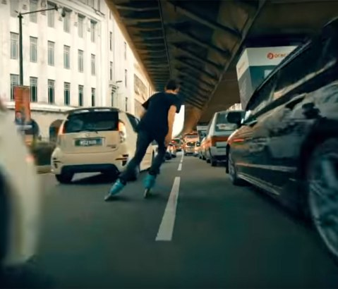 Traffic skating with Nick Lomax in Kuala Lumpur, Malayasia