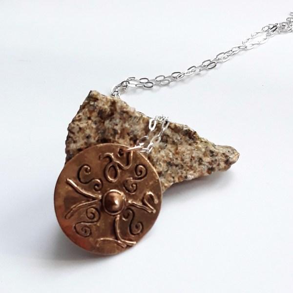 Pendentif symboles celtiques bronze