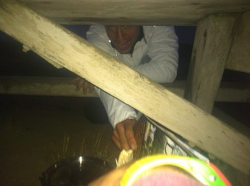 Last night cooking under a table because of the wind