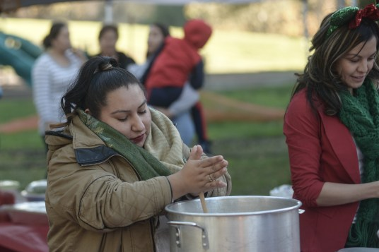 The staff and promotoras of Monument Impact worked hard to make tamales, hot chocolate, and champurrado for everyone.