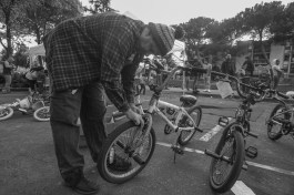 BC organizer Aaron McHugh works on a bicycle donated by Adopt-A-Family Bikes for a child recipient.