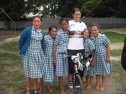 Sarah Walker poses with kids