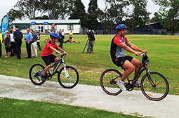 Rugby players on bikes