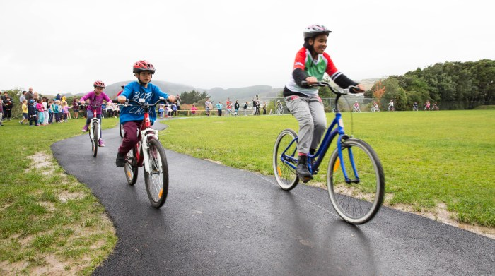Pupils zip around the newly opened riding track