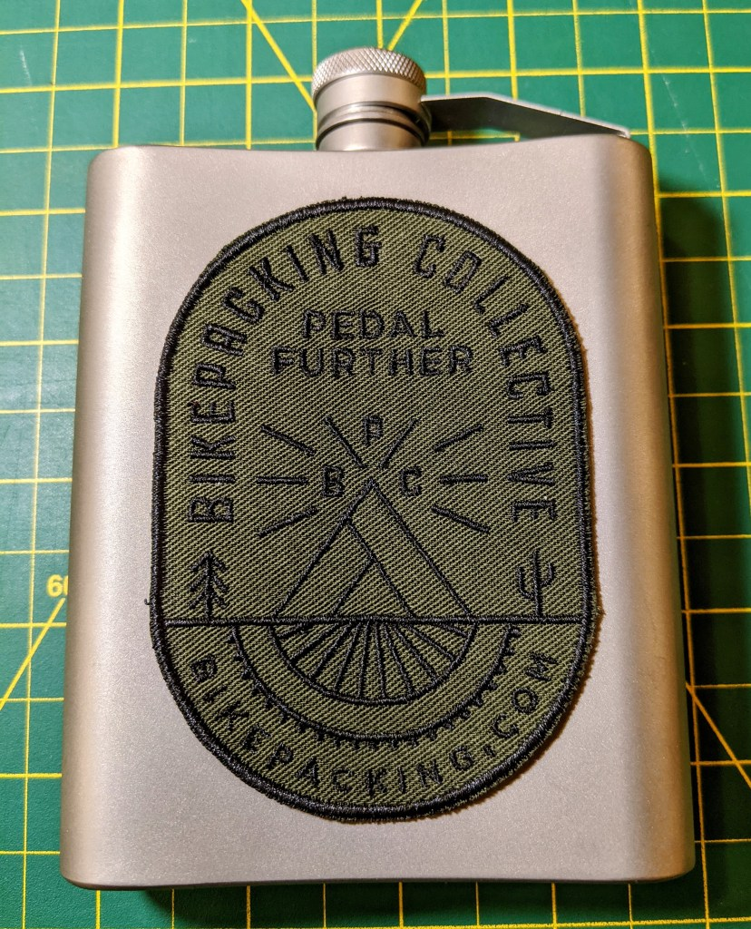 Bikepacking.com patch on a titanium flask