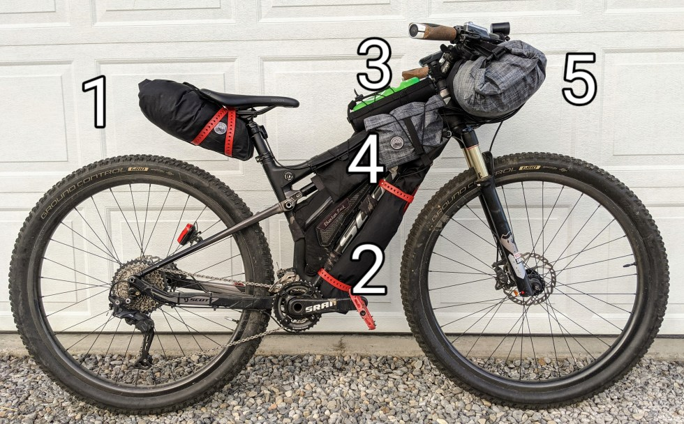 Full suspension trail bike loaded for bikepacking