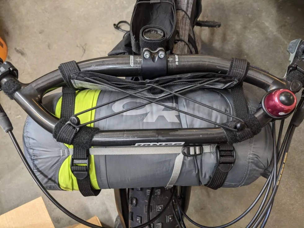Harness with an eight liter OR compression dry bag containing inflatable mattress, sleeping quilt, and clothing.