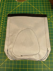 """The top edge has a double 1/2"""" fold. The sides are sewn with a 1/"""" seam allowance and the bottom corners (will be closest to the rider) are sewn to create a smooth'ish shape."""