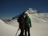 Dasha and Jakub on a top of Quarterdeck with Mt. Aspiring in the background.