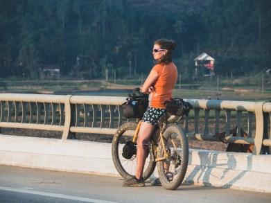Dasha is watching sunset on a bridge