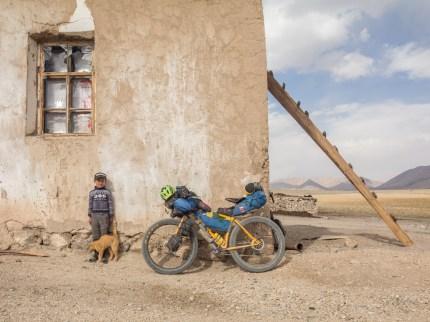 A boy and a cat. Alichur Area, Tajikistan
