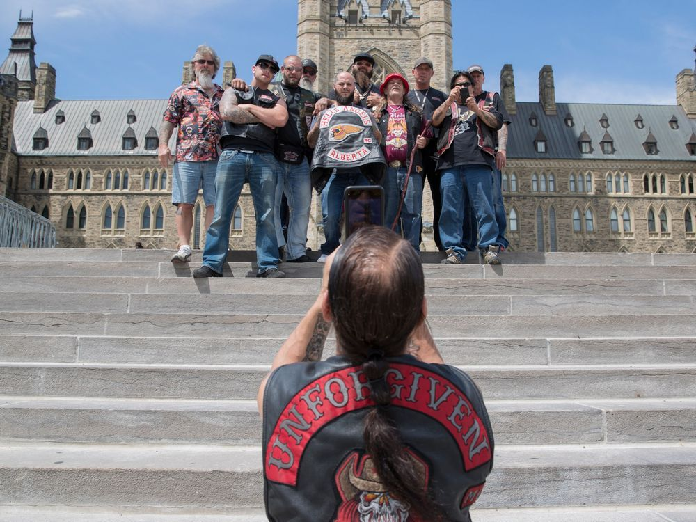 Hells Angels from Alberta pause for a photo on Parliament Hill July 23, 2016.