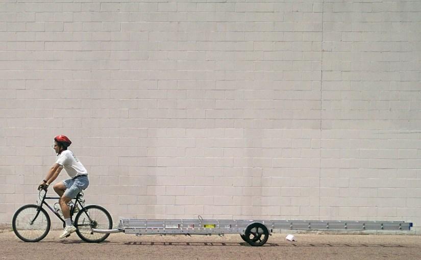 Hauling a 32 foot ladder by bike