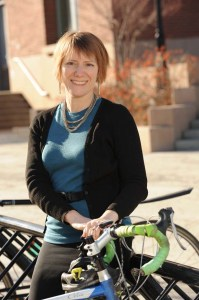 Barb Chamberlain with bicycle at bike rack