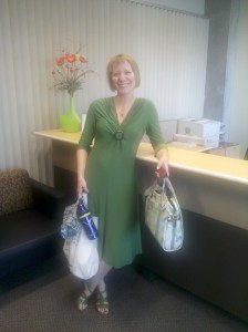 Barb Chamberlain in green jersey dress with Po Campo bags, 9-22-11