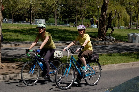 Barb Chamberlain (left) and Betsy Lawrence (right) bicycling on Spokane's South Hill, May 13, 2014.