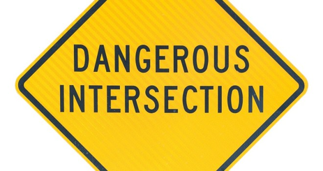 Dangerous Intersection road sign, isolated on white