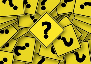 Question mark road signs, stack of signs with black question mark on yellow diamond road sign