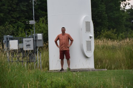 Jim in front of Northwind 100-kW Showing Scale, even for a Smaller 'Community-Scale' Turbine