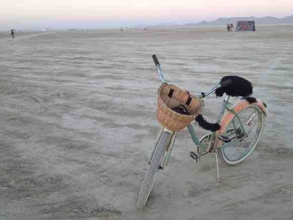 A bicycle in the mostly empty desert of burning man