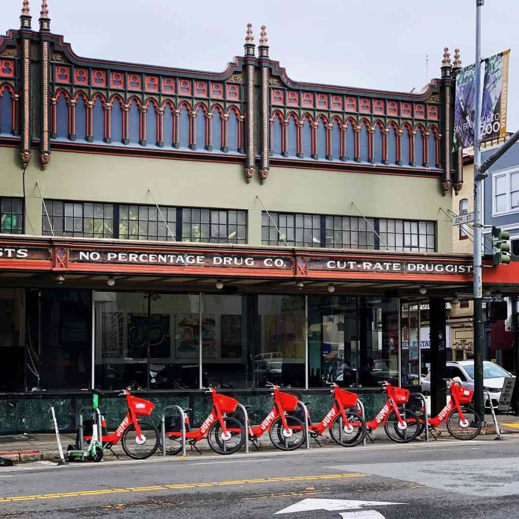 JUMP Bikeshare bikes and a lime scooter parked at a bike corral in San Francisco