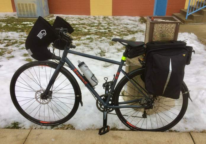 Bar mitts on a drop handlebar road bike. And of course all the panniers to carry things!