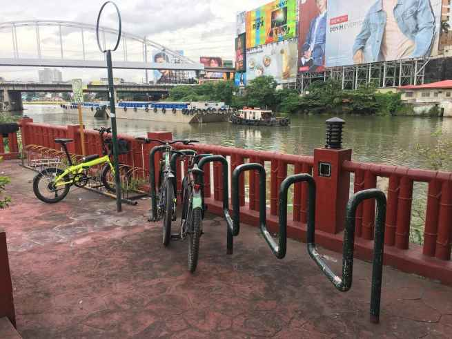 bike parking next to the river in manila