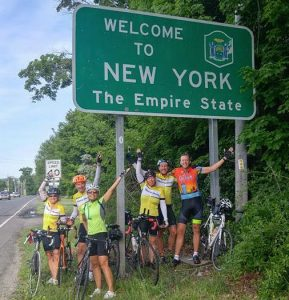 Lisa and her fellow riders celebrate reaching New York.
