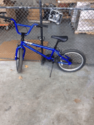 Blue BMX bike against the fence