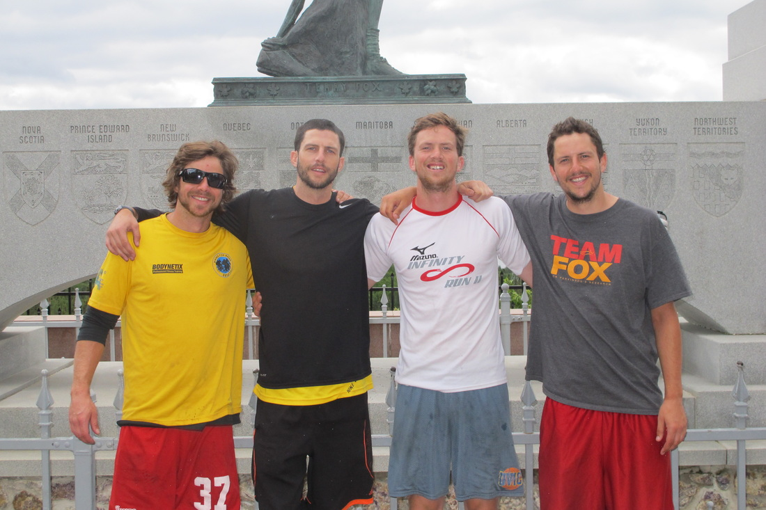 The Mackinnon Boys in front of the Terry Fox Monument.