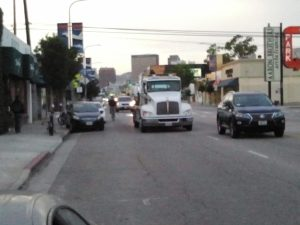 This rider on Westwood Blvd could legally take the lane, and probably should