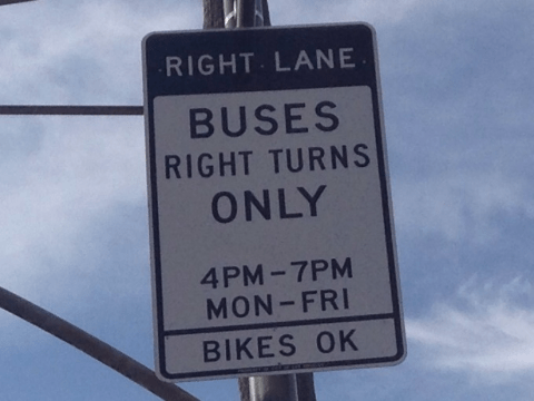 Photo of Los Angeles' peak hour bus/bike lane signage, credit: Marc Caswell