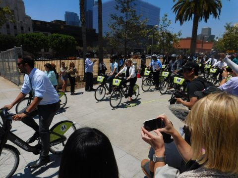LADOT GM Seleta Reynolds helps lead the ride off from Grand Park