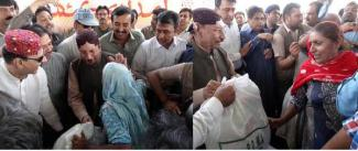 @ghuman_ar CM #Sindh Syed Qaim Ali Shah distributing relief goods among the flood affected families