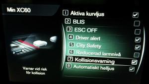 Centrumskärmens bild för val av funktioner i Volvo XC60 modellår 2015
