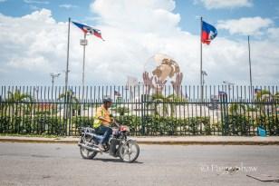 three-hand-statue-motorcyclist-port-au-prince-haiti