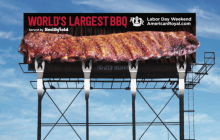 OUTFRONT and American Royal ribs billboard drips sauce.