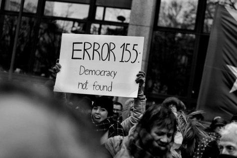 "Sign saying ""Error 155: Democracy Not Found."""