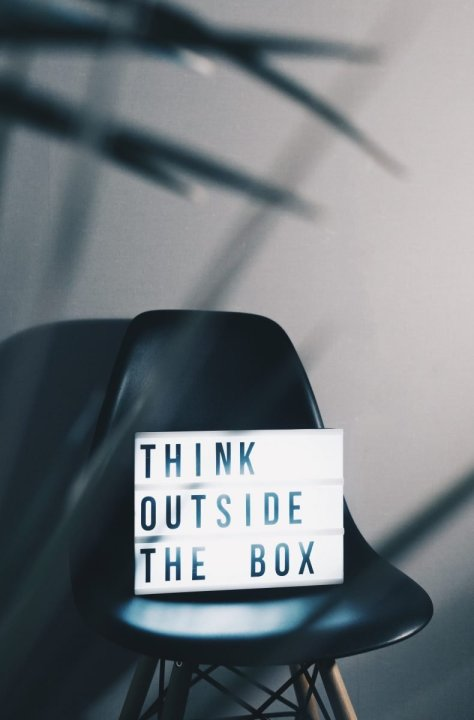 Think outside of the box sign.