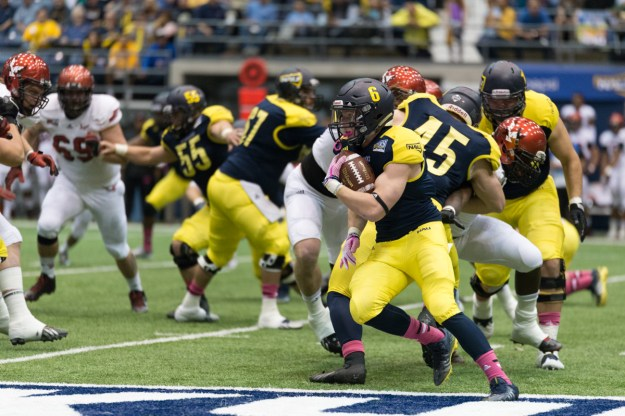 NAU running back Casey Jahn looks to turn a run north-south