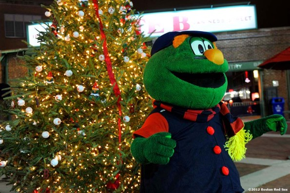 """""""Wally the Green Monster poses for photographs during Fenway Park Holiday Bash Friday, November 30, 2012. The event featured player and alumni meet and greets, a Fenway Winter Village set up in the Big Concourse, access for fans to the home clubhouse and warning track, and an LED Winter Lights musical projected on the Green Monster."""""""
