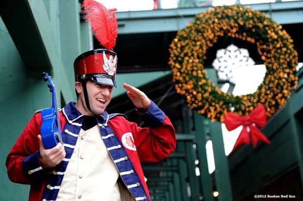 """""""Big League Brian, an entertainer on stilts, greets fans during the tenth annual Christmas at Fenway Park Saturday, December 1, 2012. The event featured player and alumni meet and greets, a Fenway Winter Village set up in the Big Concourse, access for fans to the home clubhouse and warning track, and an LED Winter Lights musical projected on the Green Monster. """""""