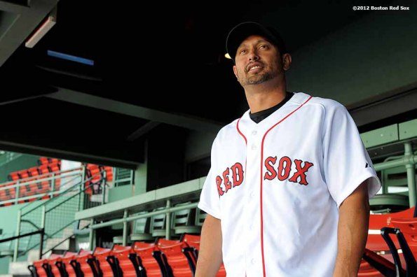 """""""Two-time All-Star and three-time Gold Glove winning outfielder Shane Victorino poses for a photograph at Fenway Park Thursday, December 13, 2012 after a press conference announcing his signing of a three-year contract."""""""