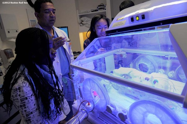 """""""Members of the 2012 class of Boston Red Sox scholars react as a talking manikin speaks to them in the Minimally Invasive Surgery wing of Beth Israel Deaconess Hospital in Boston, Massachusetts Friday, December 14, 2012. The scholars toured the hospital as part of their holiday celebrations."""""""