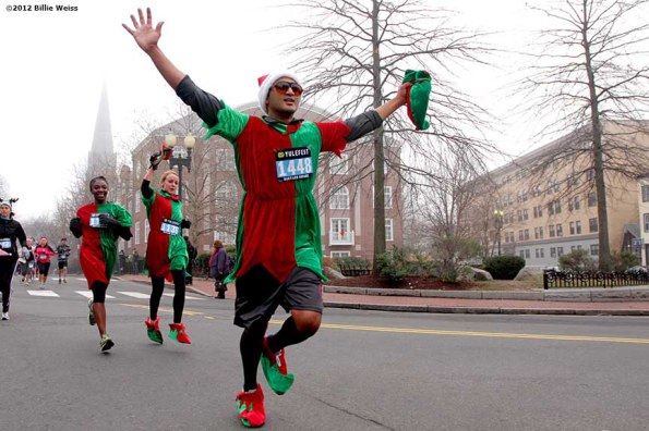 """""""A runner gestures as he races in Yulefest, a holiday themed 5K race in Cambridge, Massachusetts Sunday, December 2, 2012."""""""