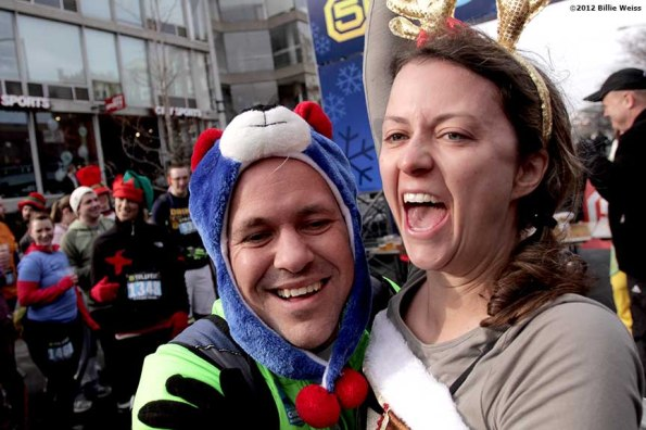 """""""Guests celebrate after winning a dance-off competition during Yulefest, a holiday themed 5K race in Cambridge, Massachusetts Sunday, December 2, 2012."""""""