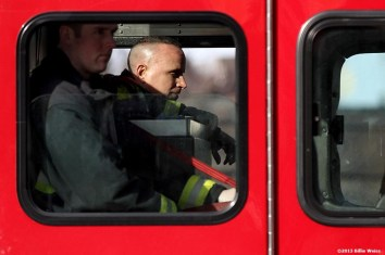 April 15, 2013 - Boston, Massachusetts, United States: A member of the Boston Fire Department reacts in a firetruck after two bombs were detonated at the finish line of the 2013 Boston Marathon. (Billie Weiss)
